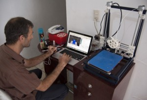 Engineer Matt Rogge demonstrates the 3D printer he built at the FabLab in Oaxaca, Mexico.