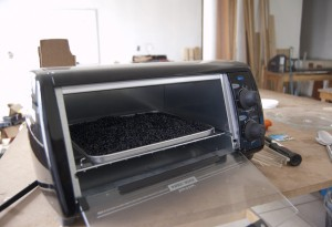 The engineers at the FabLab in Oaxaca, Mexico, use a toaster-oven to heat plastic pellets.