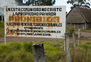 "Outside Ixtlán de Juárez, Mexico, a sign warns visitors that ""In this community, private property does not exist. The purchase and sale of communal lands is prohibited."" Lucas Laursen."