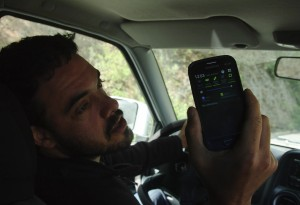 Peter Bloom of Rhizomatica shows off the signal strength on a handset outside of Talea de Castro, Mexico. December 2014. Lucas Laursen.