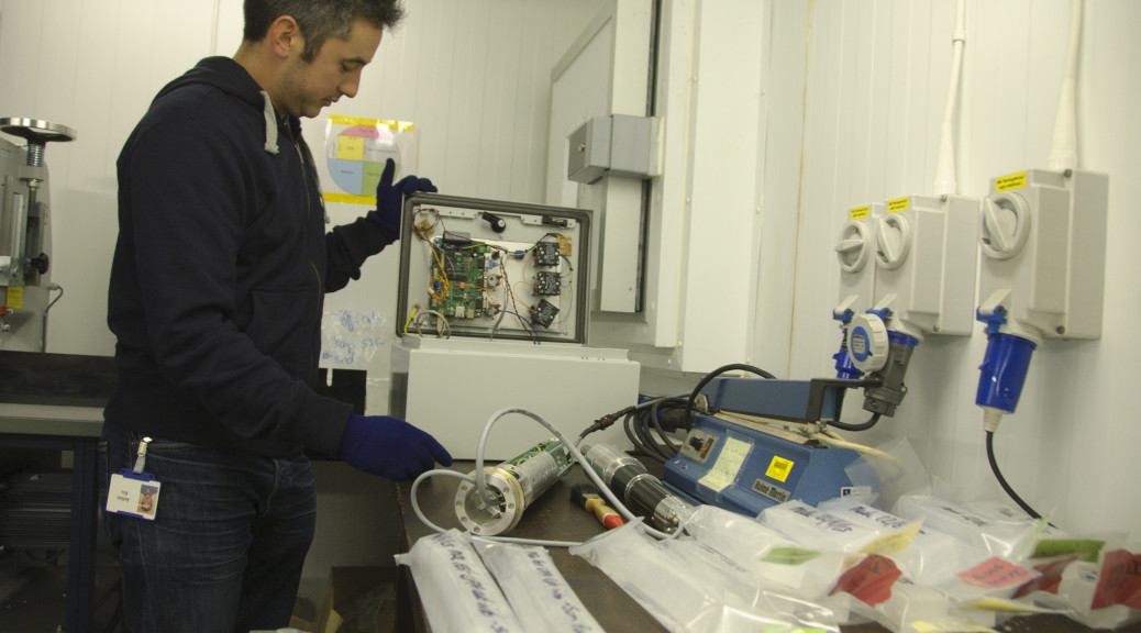 Julius Rix works on systems that will be used to drill through ice to extract samples.